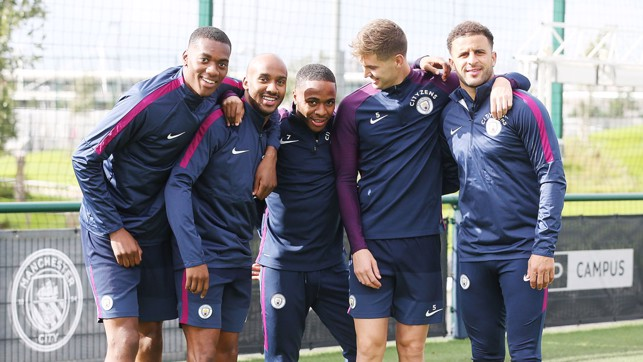 SUNNY SMILES: The players dodged the Manchester showers