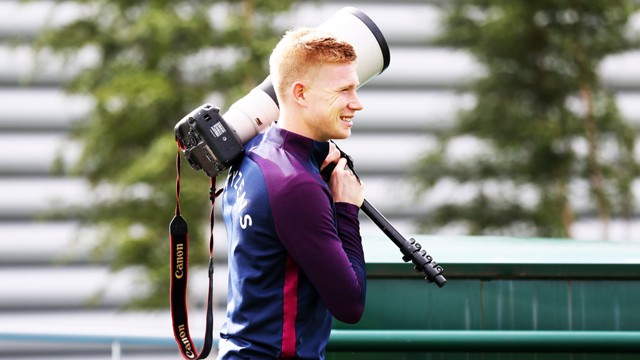 MAY I ASSIST YOU? Kevin De Bruyne helps with the camera gear