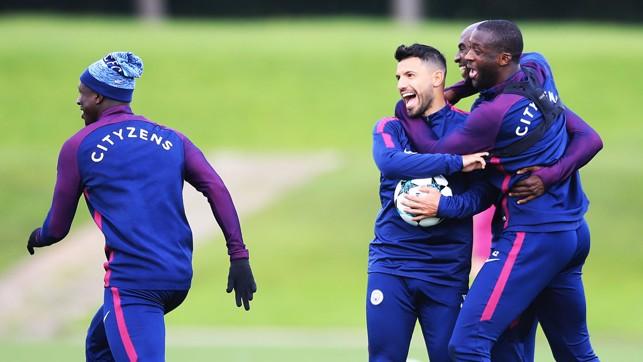 MY BALL: Aguero (centre) has a laugh