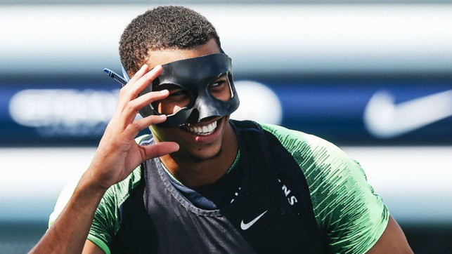 MASKED BALL: Lukas Nmecha has some fun and games with Ilkay Gundogan's protective mask