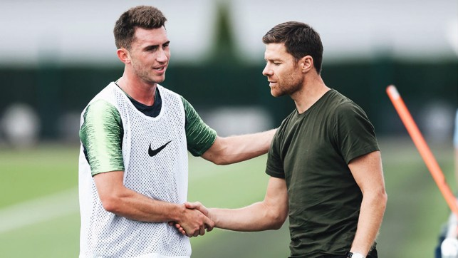 X FACTOR: Spanish legend Xabi Alonso, who played under Pep Guardiola at Bayern Munich was at the CFA today and here exchanges greetings with Aymeric Laporte