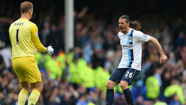 TEAM MATES: Hart celebrates with Demichelis during our win away at Everton in 2014.