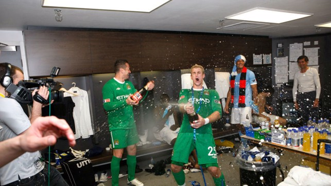 CELEBRATIONS: Excitement in the dressing room after City's FA Cup win in 2011.