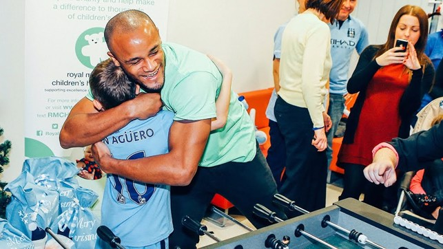 LITTLE AND LARGE: Kompany hugs a young fan while on hospital visit.