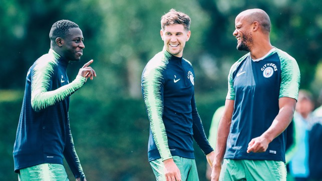 LISTEN UP! Benjamin Mendy makes his point to John Stones and Vincent Kompany