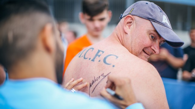 SIGNING: He even signed a fan's back!