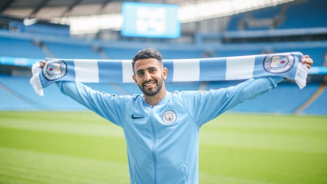 WRAP UP: It may be warm in Manchester but it's never too hot for a City scarf!