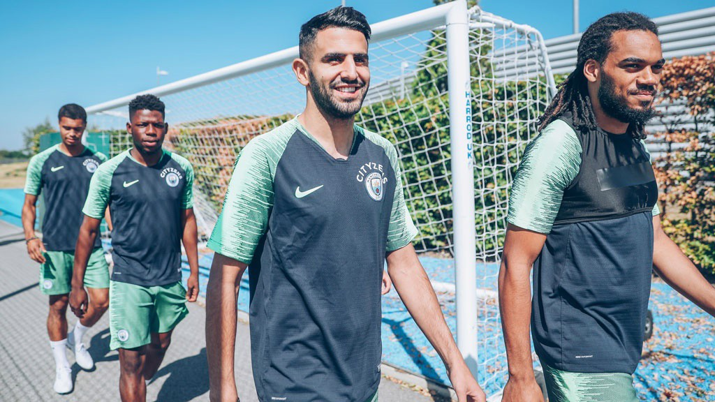 WALK THIS WAY: Riyad alongside Jason Denayer