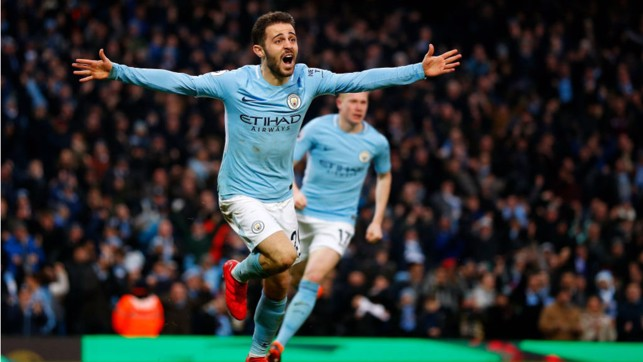 CAPITAL GAINS: The Portuguese marvel wheels away in delight after netting a crucial league winner against Chelsea in March 2018