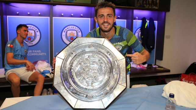 SMILES OF SUCCESS: Bernardo and City celebrate another piece of silverware after our Community Shield win over Chelsea in August 2018