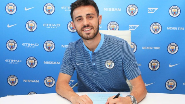 TRUE BLUE : Bernardo is all smiles after signing for City in the summer of 2017