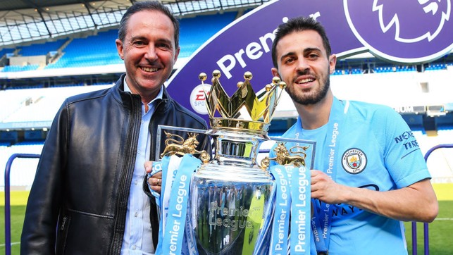 FAMILY AFFAIR: Bernardo and his proud father pose with the Premier League trophy after City's record-breaking 2017/18 title success
