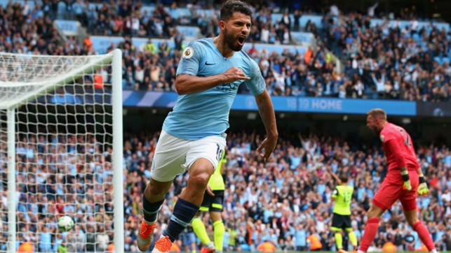 TERRIERS TERRORISED: Sergio Aguero celebrates the first of six City goals against Huddersfield Town