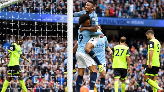 HIT FOR SIX: Gabriel Jesus and Leroy Sane celebrate one of City's six goals against Huddersfield Town