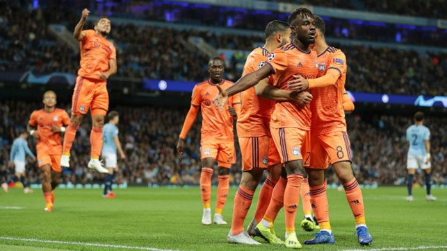 SETBACK: Lyon's Maxwell Cornet celebrates his side's first in the 2-1 loss in the opening game of this season's Champions League