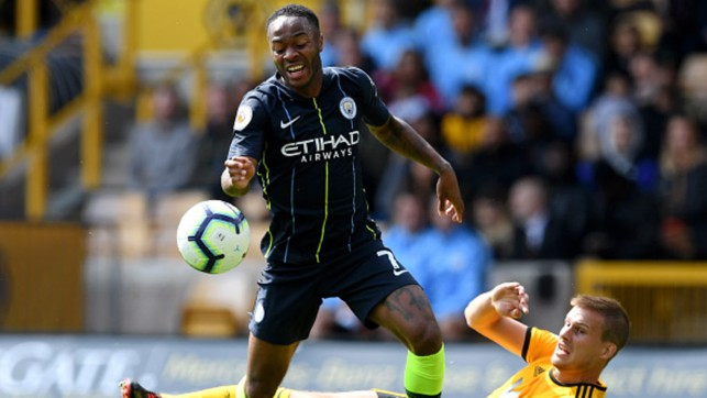 TOUGH TEST: Raheem Sterling evades the attentions of Ryan Bennett as City battle to a 1-1 draw at Molineux