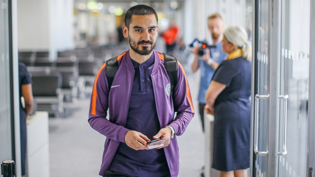 GUNDO: Ilkay steps on the plane ready to return to Germany.