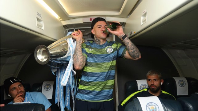DRINKING IT ALL IN: Ederson savours the moment with a drink - and the Premier League title!