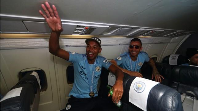 BRAZILIAN BLEND: Even at 30,000 feet Fernandinho and Danilo are still full of the party spirit
