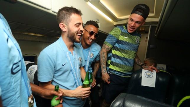 CABIN FEVER: Bernardo Silva, Danilo and Ederson just can't contain their joy