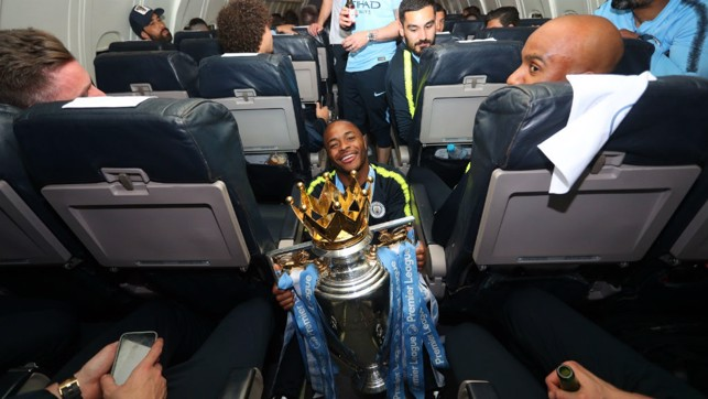 SITTING PRETTY: Raheem Sterling gets his hands on the trophy