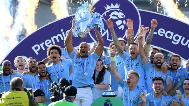 CHAMPIONS: Vincent Kompany lifts City's fourth Premier League trophy aloft