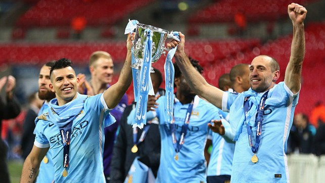 CAPITAL GAINS: Kun and Pablo Zabaleta lift the League Cup trophy aloft after our 2016 Capital One Cup final win over Liverpool
