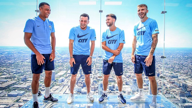 ALL SMILES: The lads see the funny side of being stood on a glass floor