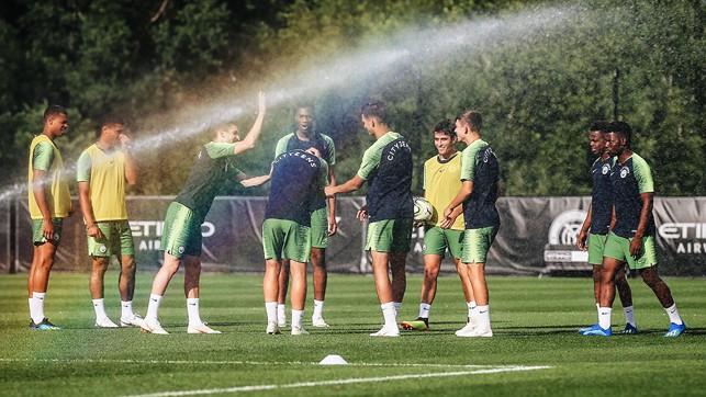 WET, WET, WET: Caught by the sprinkler!