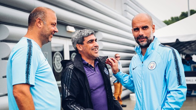 GREAT MINDS: Claudio and Pep have a quick chat before training