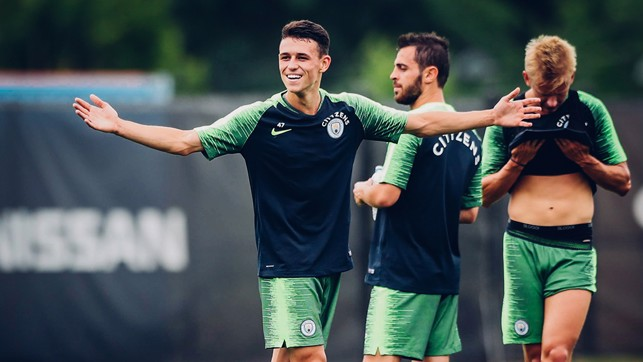 WHAT'S UP: Phil Foden reacts to something during training