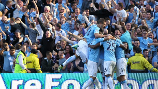 TOGETHER: Celebration time as Sergio Aguero opens the scoring in 2013's 4-1 victory.