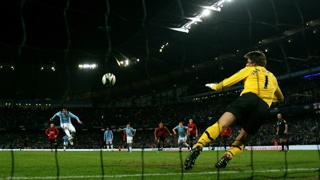 FROM THE SPOT: Carlos Tevez scores against his former club in the first leg of the 2010 League Cup semi-final.