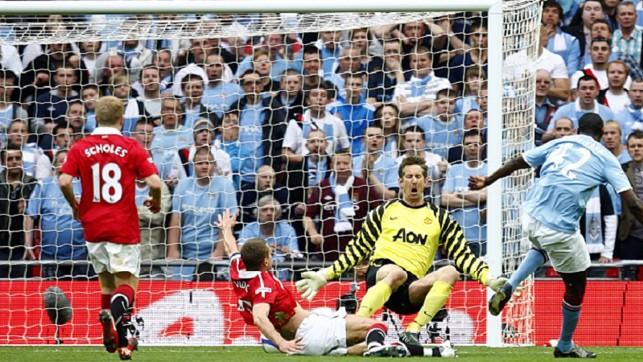 WEMBLEY: Yaya Toure nets through Edwin van der Sar's legs to send City through to the 2011 FA Cup final.