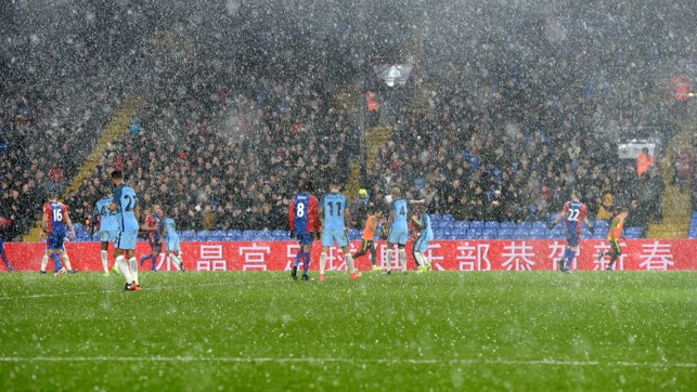 WILD WEATHER: The elements take a turn for the worse during the Fourth Round clash at Selhurst Park.