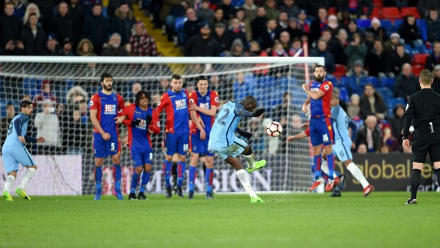 YOU BEAUTY!: Yaya curls home a free kick in added time to seal the 3-0 victory.