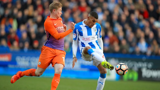 APPLYING THE PRESSURE: Kevin De Bruyne tries to nick the ball from Huddersfield's Collin Quaner.
