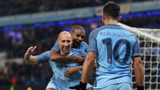 SMILES ALL ROUND: Pablo Zabaleta makes his way over to Aguero after the latter set him up for City's third goal of the evening.