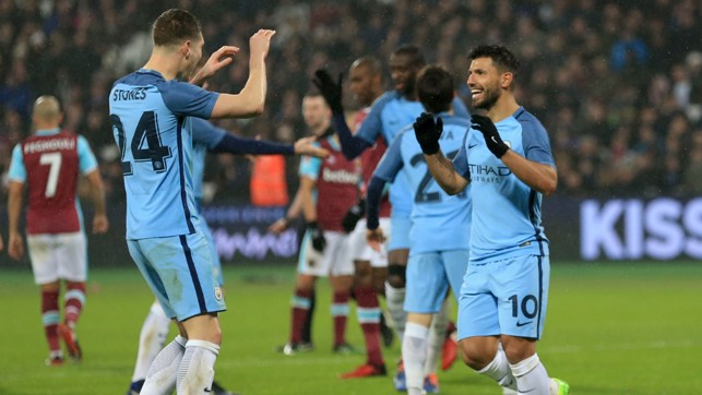 HIGH FIVE: John Stones greets Sergio Aguero after our number 10 gave City a 4-0 lead.