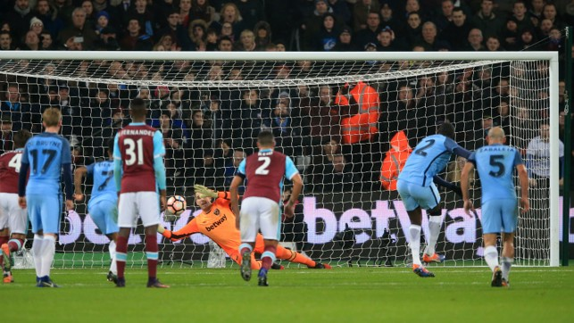 OUT OF REACH: Yaya Toure converts a penalty to give the Blues the lead at the London Stadium.