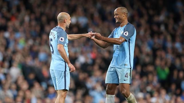 CAPTAIN: Vincent Kompany gives Pablo Zabaleta the captain's armband.
