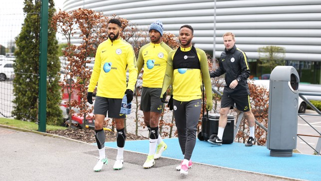 THREE AMIGOS: Gael Clichy, Fabian Delph and Raheem Sterling head out for the session.