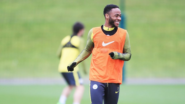 SMILES FROM STERLING: Raheem was enjoying himself out on the training pitch.