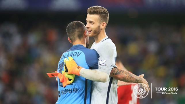 HUG ME: Kolarov greets the hero of the hour.