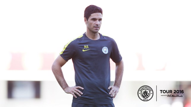 ALL-SEEING EYE: Mikel Arteta watches over as the squad go through their paces.