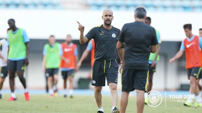TAKING CHARGE: Pep signals what he wants from his team.