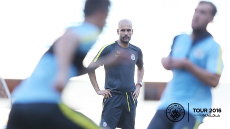 EL SENOR: Pep keeps watch over the youngsters in Shenzhen.