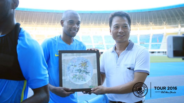 A GIFT: Fernandinho looks pleased with his present.