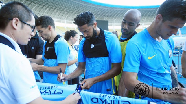 SIGNING SESSION: Clichy delights fans along with his teammates