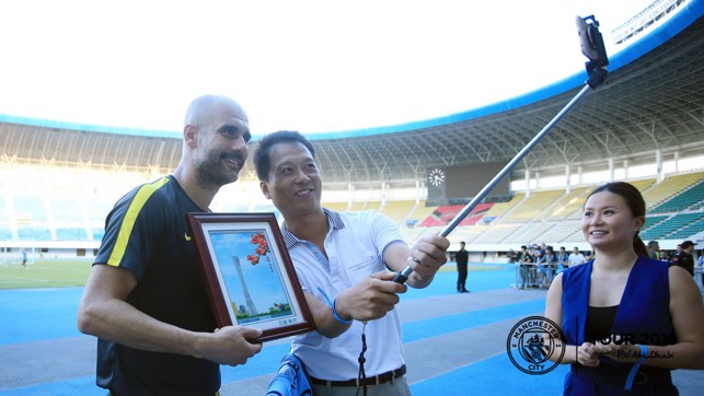STICK-ING WITH YOU: Pep poses for another selfie